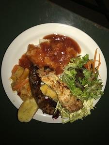 Boerewors sausage, grilled chicken, polenta with tomato sauce, salad