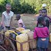 Iraqw children getting water at community well - Karatu, Ngorongoro Highlands