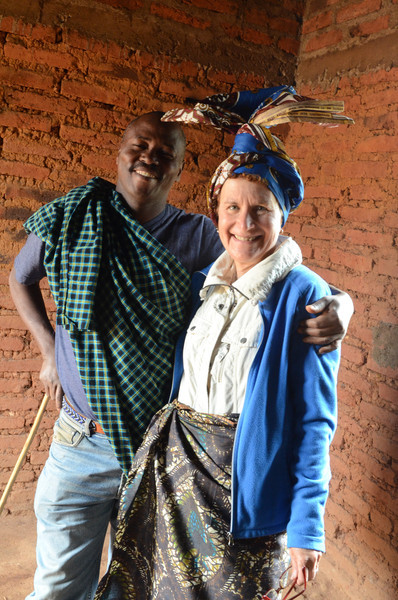 Local Iraqw guide with Bev in traditional headscarf and skirt - Karatu, Ngorongoro Highlands