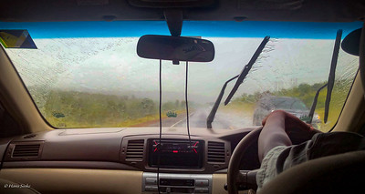 The first rain this trip (and not the last!) In the cab on our way to Nanyuki for the registration.