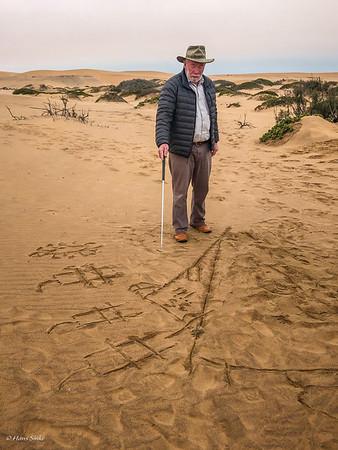 Douglas explaining the foodchain in the Namib Desert. Desert muesli is where it all starts