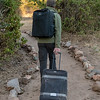 Taking the suitcase for Ruaha Carnivore Project to reception for pick-up by Ana