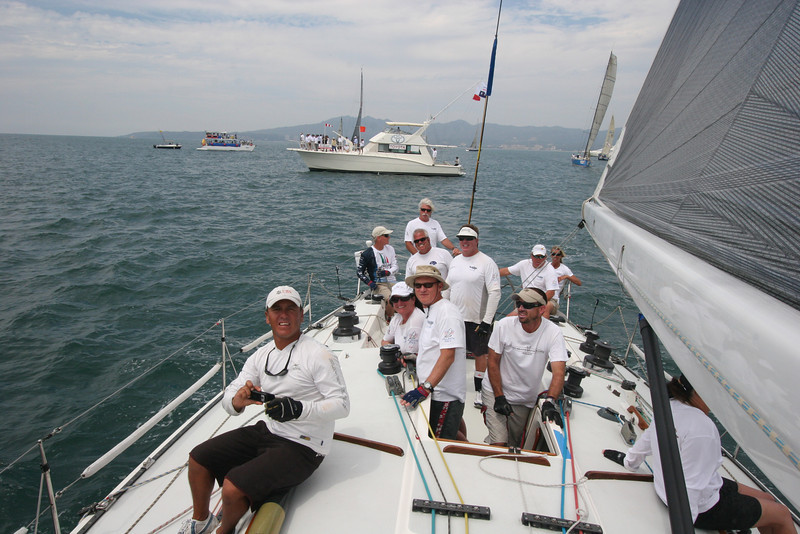 The crew of Relentless sails in front of the MEXORC committee boat, which had Mexican President Felipe Calderon on board.
