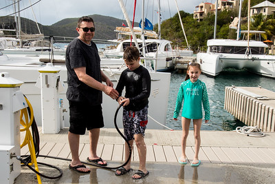 The kids return from the pool and get hosed down by Rob.  Anyone with Dream Yacht Charter has full use of the resort amenities.