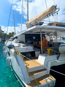 Linda exploring the boat.  So much to see!  We got the option of the wood like finish.  It is supposed to not stain.  Lets see how well it wears but I loved how it looks.