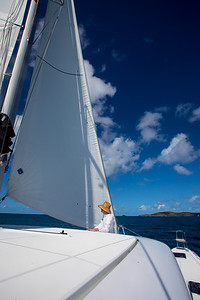 Matthew feeling the difference in the speed of wind on the leeward and windward side of the jib (the sail in the front)