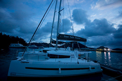 The Dream Yacht base on Praslin Island is only steps away from the Cat Cocos on Baie Ste Anne.  The ferry terminal is visible in the background with lights.