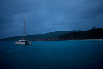 Early morning in the anchorage at La Digue.  The catamarans have their anchor lights on.