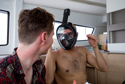 Danny tries on the full face snorkels they had brought with them.  DYC only had four sets which was bothersome.  They had promised more but we forgot to pick them up.  It turned out that the full face masks leaked snd didnt work out so well.