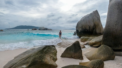 Anisa exploring the rocks on Cocos Island.  There were so many crabs scuttling around.