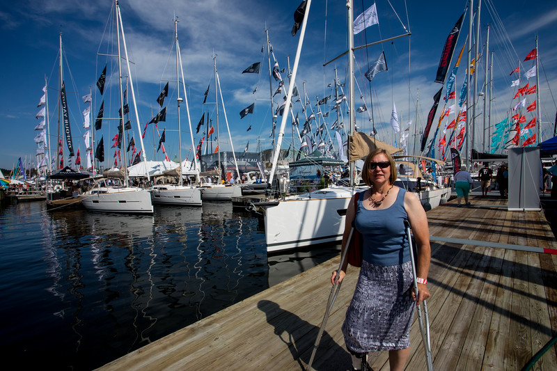 The first day of the show was beautiful and hot.  We were worried how Linda would be able to get around with bobbing docks and being on a crutch.  So she brought the second crutch to make it easier and did an awesome job getting around and on boats.