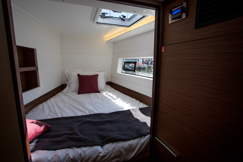 Lagoon 42.  Forward Cabin.  Have to get in from the end.  Not an exciting prospect.  But it does have shelves.