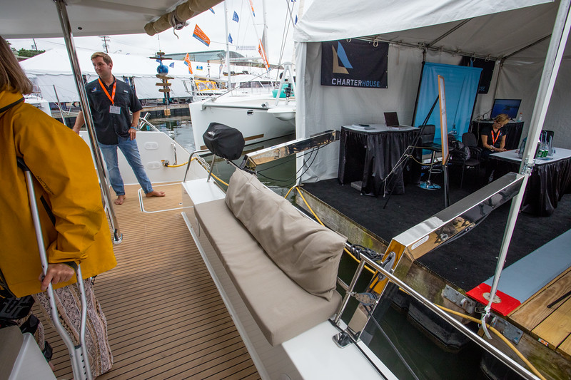 FP Helia 44.  A bench seat by the stern.  The chrome davits are for raising and lowering a rubber dinghy for going into shore.  There is a barbecue on the side.