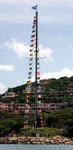 Flags mark the entrance into the Porto Cervo harbor.