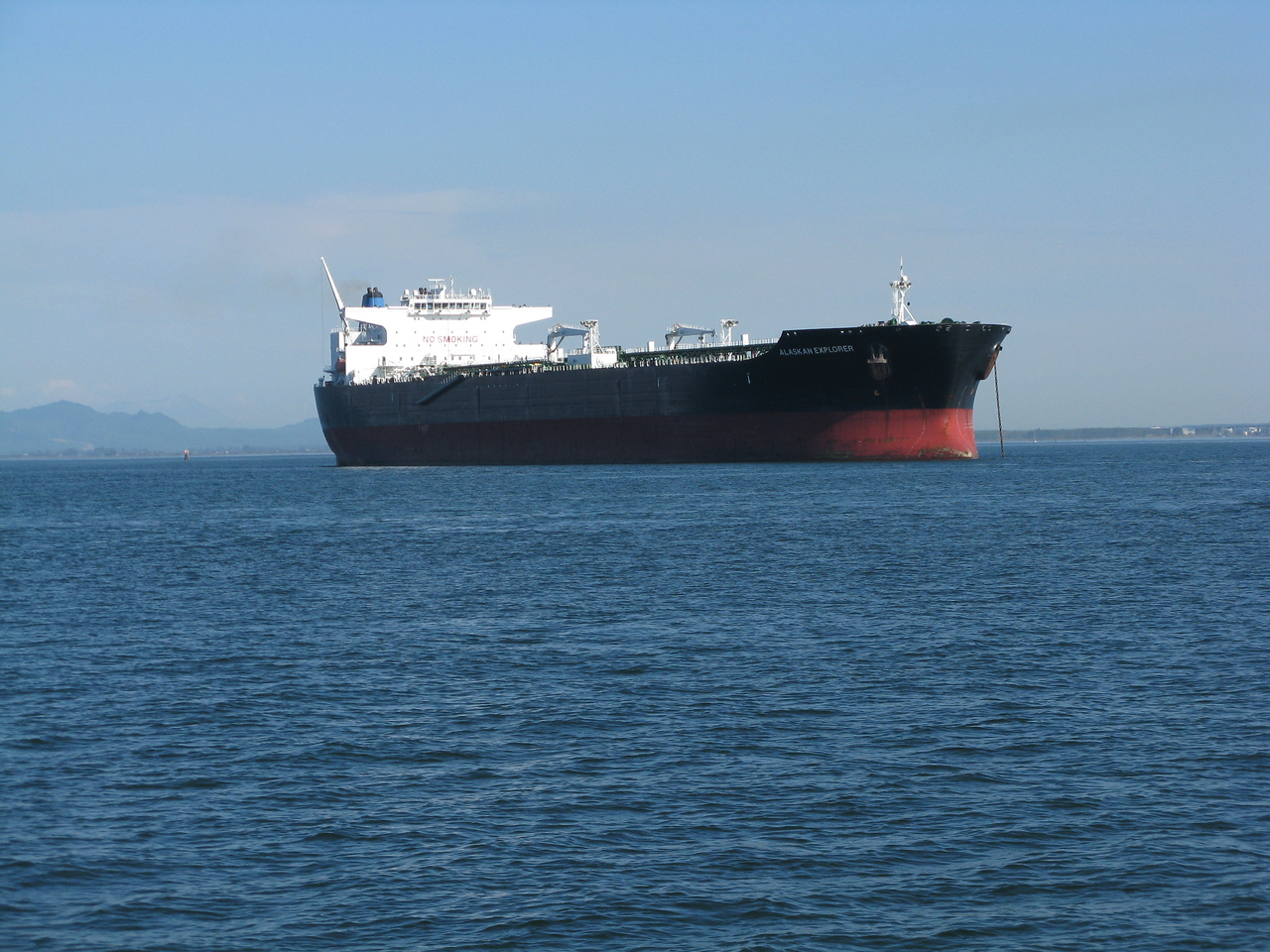 An oil tanker, apparently empty, anchored off the refinery east of Anacortes.