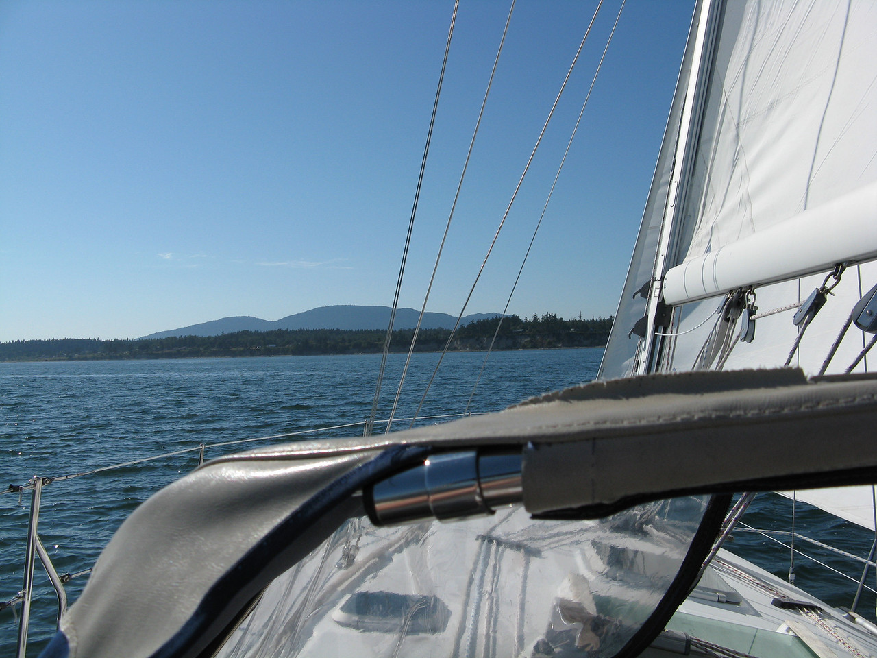 After being checked out by the charter company, Keegan, Ann, Nathan and Martin went sailing on Fidalgo Bay, east of Anacortes.  Glenn, Sonia and Abby arrived after dark.  This photo shows the boat beating into the wind on a port tack on a beautiful afternoon on Fidalgo Bay.
