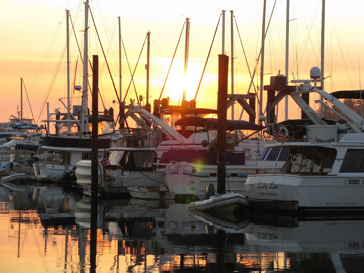 On Tuesday morning, sunrise is brilliant over the boats at Friday Harbor.