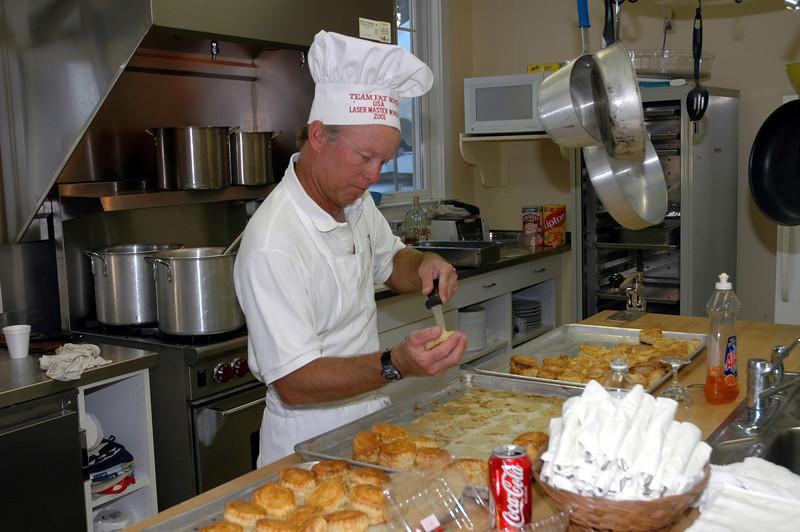 Steve Swenson helping prepare dinner.