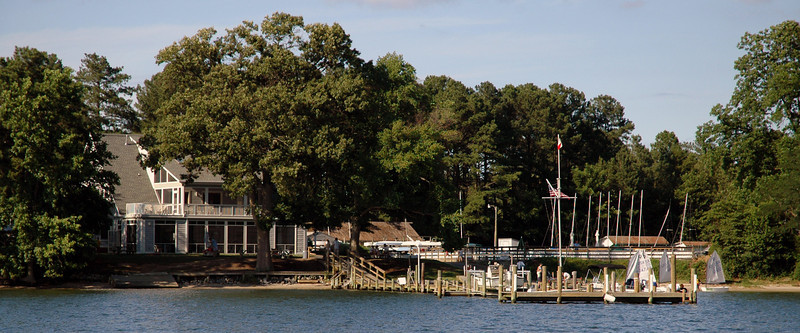 Fishing Bay Yacht Club seen from the water at high tide.