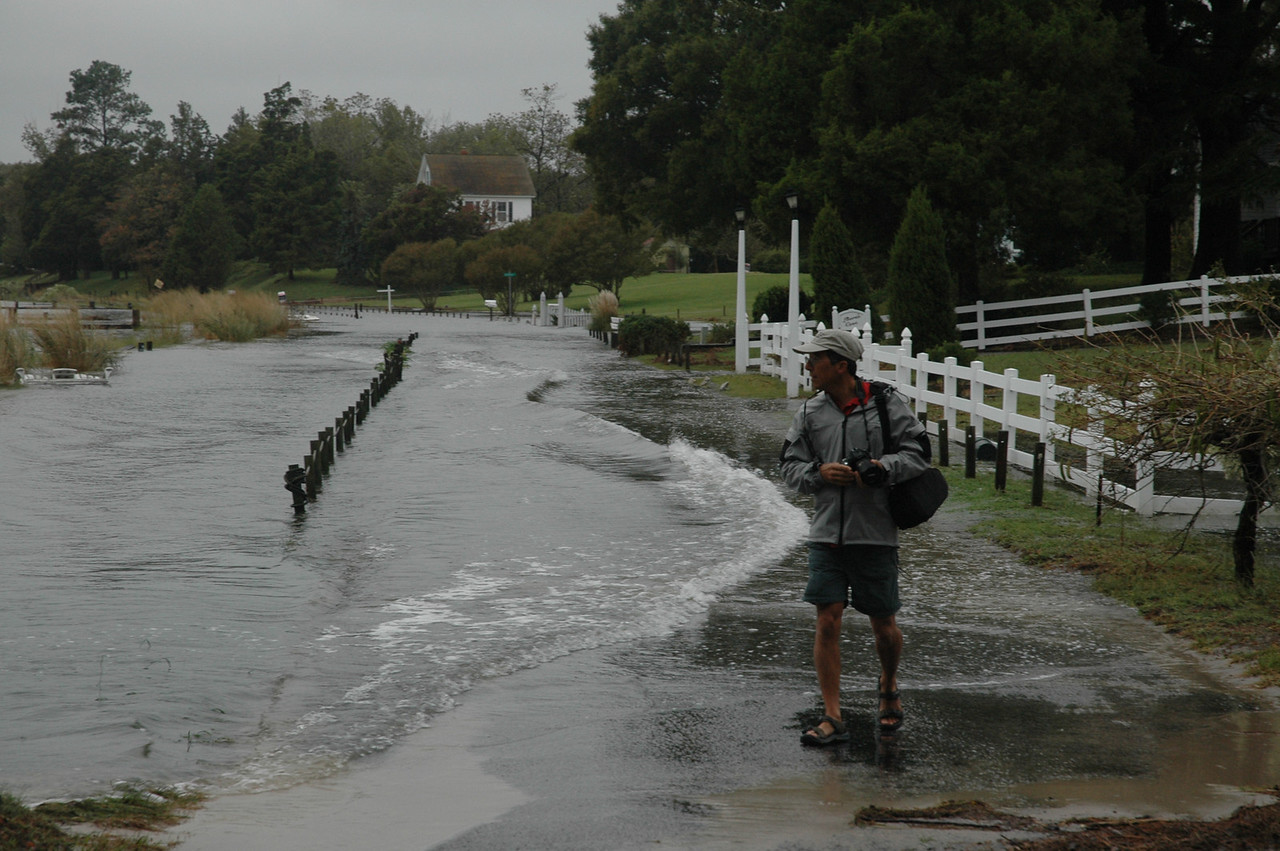 Waves break over Fishing Bay Road.