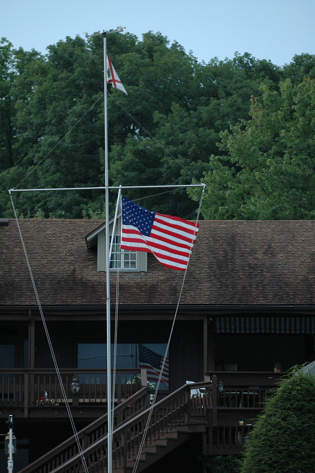 Burgee and American flag flying in front of Deep Creek Yacht Club
