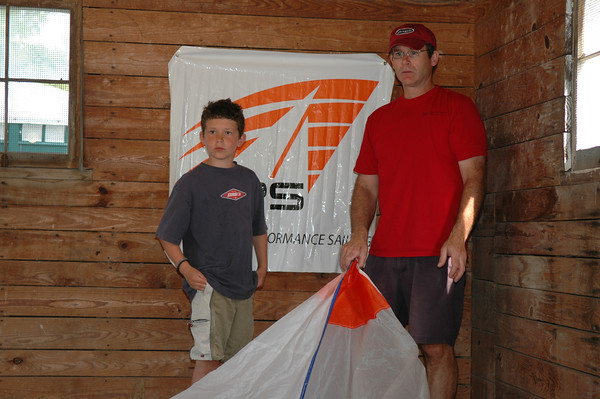 Len Guenther measuring sails with Elliot Lee