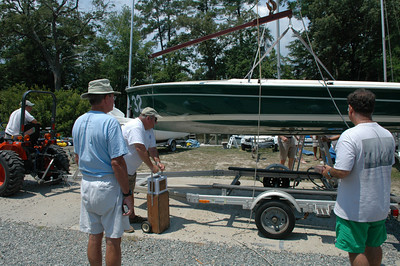 John Beery and Frank Murphy weighing boats