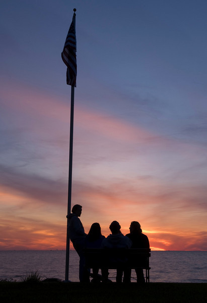 Sitting on the shore of Lake Erie in Vermilion Ohio watching the sunset.