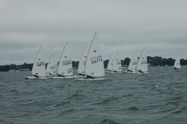 Fleet sailing upwind on race 3.