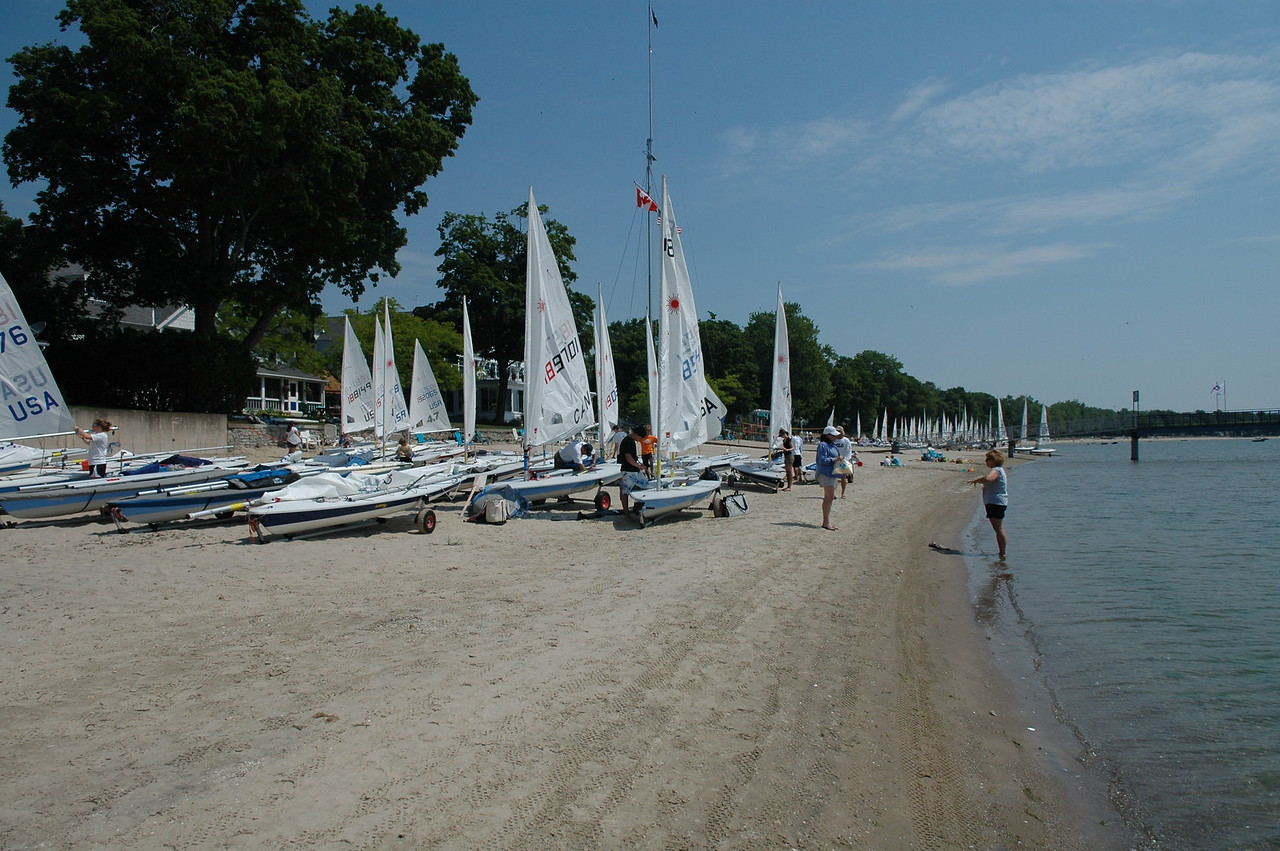 Looking down the beach of lasers being rigged for day 1 at the Laser North American Championship