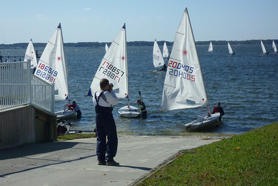 Jon Deutsch taking photos of the sailors launching.