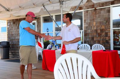 Jon Deutsch receiving an award from Ted Cremer