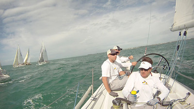 Screen capture from our onboard video. Brain trust at the back of the boat: Rob, Travis, John