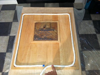 Completed board with the frame around the relief and the rope sitting in place.