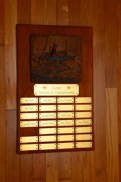 The original Standard Laser District 11 Championship trophy. It was built in 1979 by Mike waters with a relief of a Laser created by his wife Jane Waters.  The trophy was lost to time in the 80's and found about 5 years ago, but after a new District 11 Championship trophy had been created.