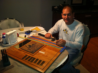 Jon Deutsch measuring out the plaques and installing them on the trophy.
