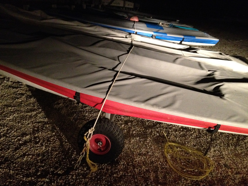 tying the boats down as a storm that produced tornados in Virginia hits NJ.
