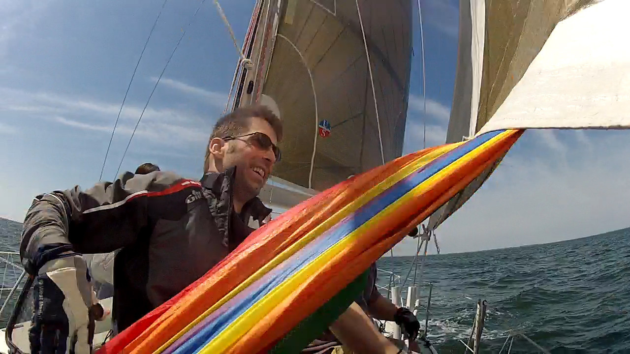 4/14 Opening Day Eric Brendle bringing in the spinnaker.