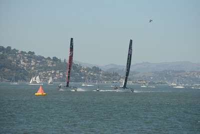 Emirates Team New Zealand and Oracle Team USA during Race 1 of the 34th America's Cup in San Francisco, California September 7, 2013.