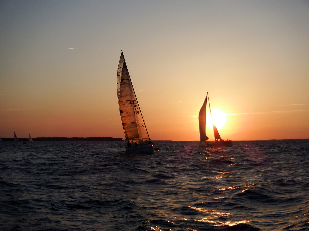 Double Eagle sailing by Nereid in the sunset.