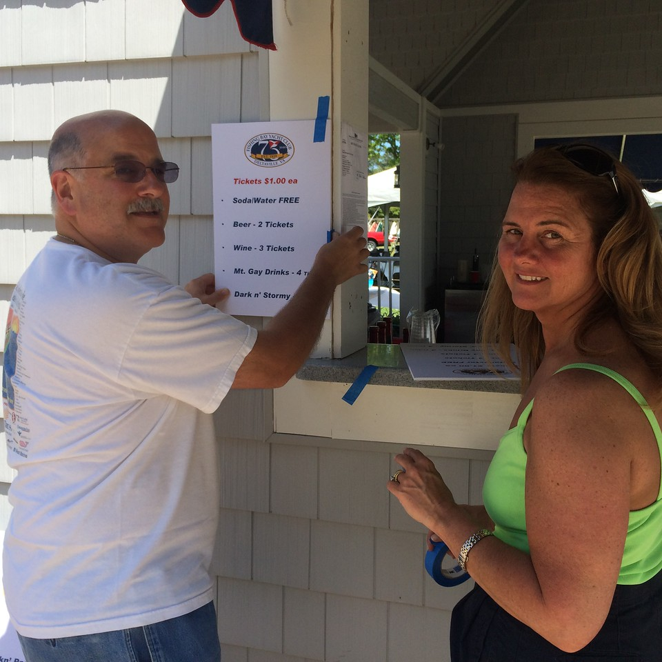 5/24 Open House Regatta Carl Simon and Elizabeth Staas getting ready for the party.
