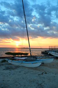 Sun setting behind hobie on LBI