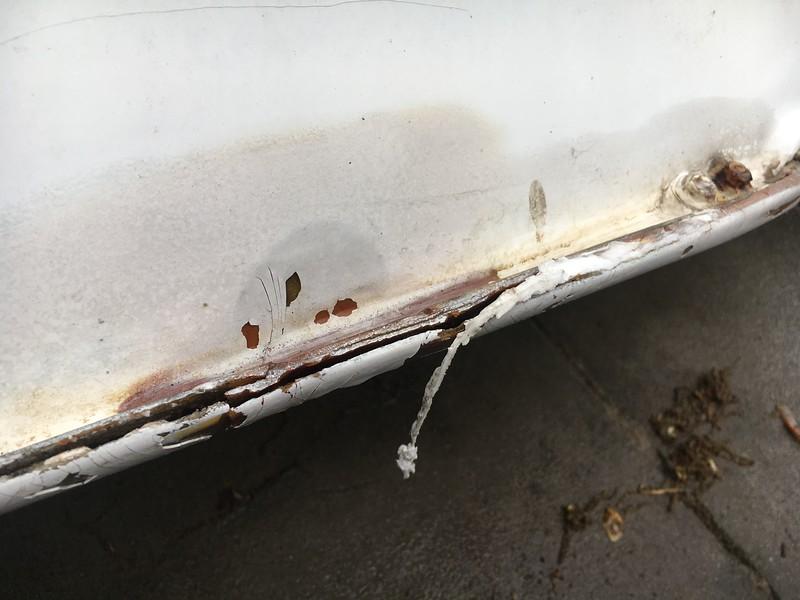 smashed rail needing repair.