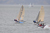 Speed boat working hard to keep up - going upwind!
