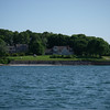 The entrance to West Harbor, Fishers Island, New York.  If you look closely on the seawall, you can see a fun message.  It comes as such a surprise, given the upscale nature of the houses and grounds…
