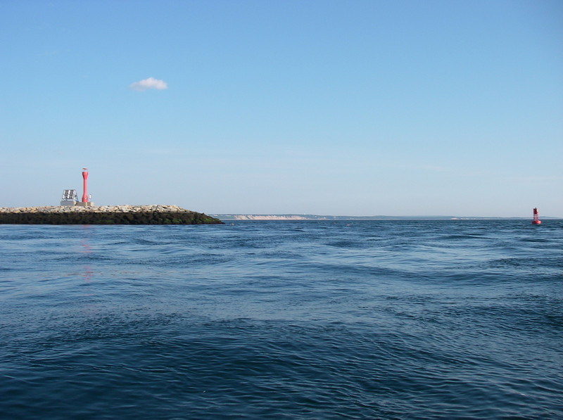 The view looking north, coming out of the canal breakwaters.  Plymouth is past that very far blue point.  July, 2012.