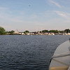 "North Cove, Essex, south-looking view of the channel that winds right through the middle of that collection of marinas and back out to the Connecticut River.  The folks at the marina on the left were surprisingly unkind, except for the very first person I talked with on the phone there.  Of course I should not have tied to one of their seemingly abandoned piles, and then been silly enough to call to ask if it was okay!  They get the ""inhospitable"" prize for the entire seven-month trip, having made a special run out in a workboat to be incredibly grouchy about it all.  Good heavens!"