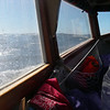 Wider view from the inside. Rhode Island sound, wind about 20 kn, gusting to 30.  Seas about 5 feet.  So nice to come in out of the wind, with the autopilot managing nicely!  October, 2012.  Photo: Shemaya Laurel