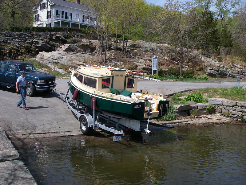 Deep River, Connecticut town boat ramp.  The trailer extension is opened up, and Melissa has switched over to the hitch on the front of their truck.  April 20, 2012.