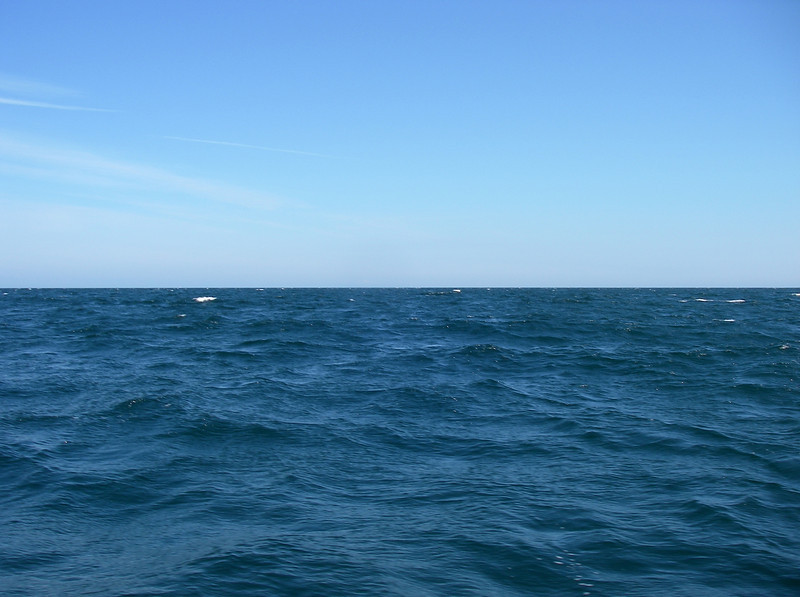 Looking out across Cape Cod Bay – Provincetown is over there, but completely below the horizon about 25 miles away.  July, 2012.
